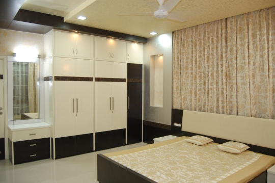 A modern Bed room using a combination of paint, veneer and coconut panel